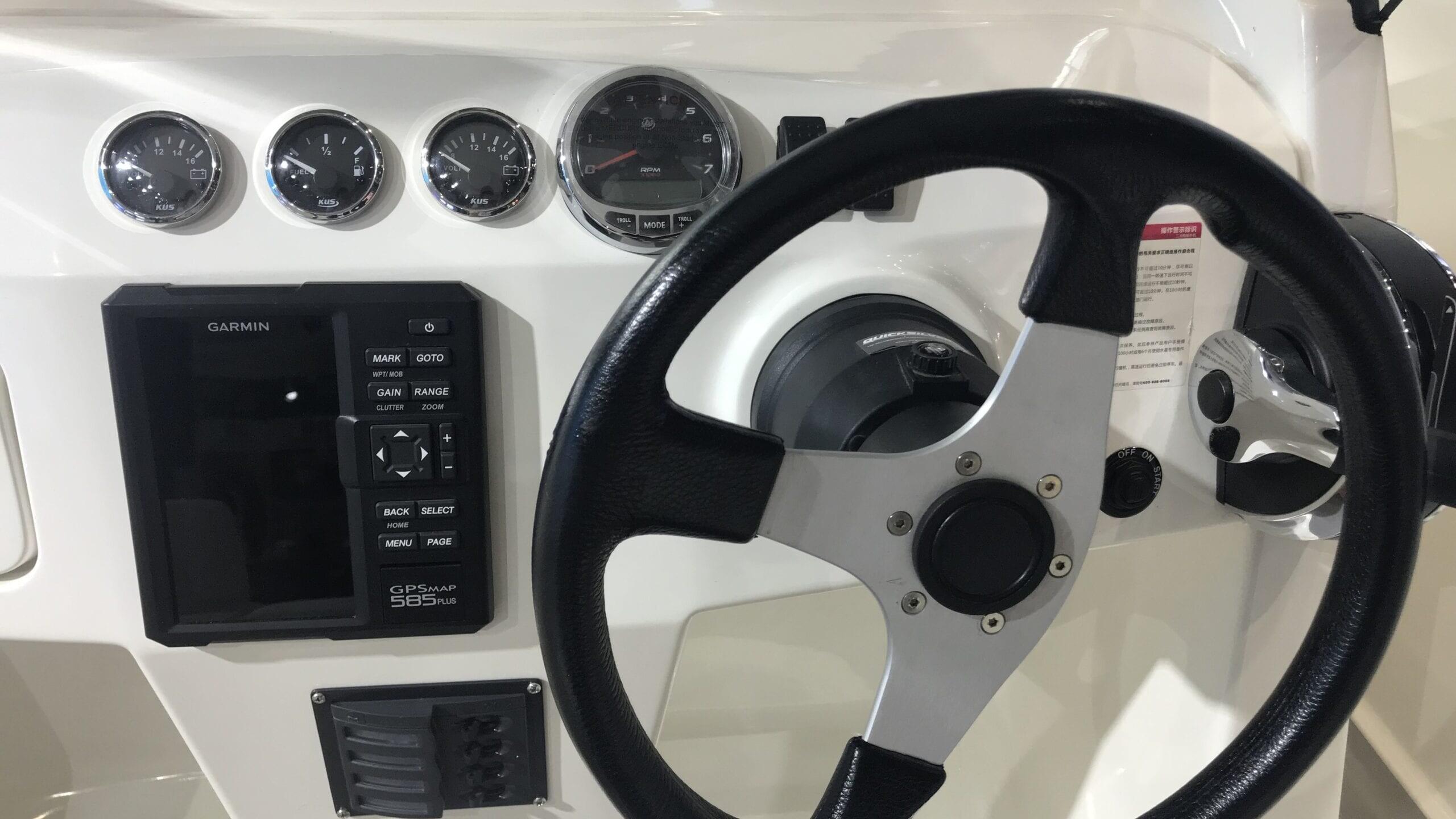 KUS Voltmeter & Fuel Gauge Alongside Tachometer & Garmin GPS
